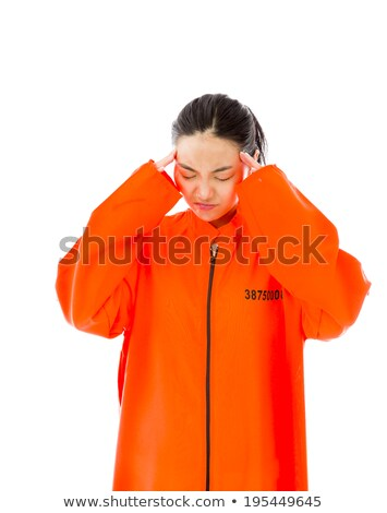 Young Asian woman suffering from headache in prisoners uniform Stock photo © bmonteny