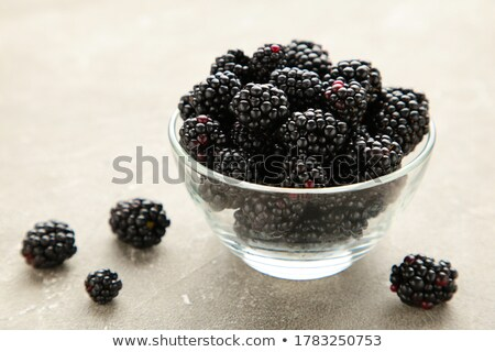 Stock photo: Ripe Blackberries in the Glass Bowl on Wooden Background