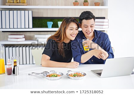 Young couple working in kitchen stock photo © jiri_miklo