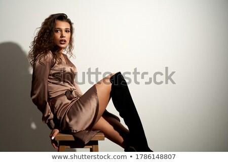 érzéki · barna · hajú · fekete · ruha · néz · kamera · közelkép - stock fotó © arturkurjan