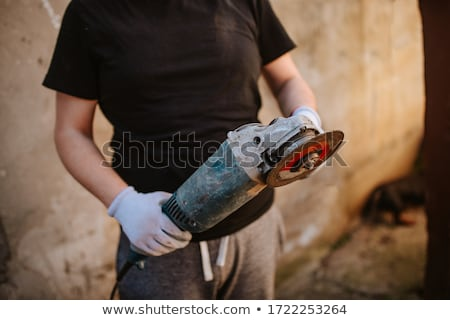 construction worker on site holding circular saw Сток-фото © highwaystarz