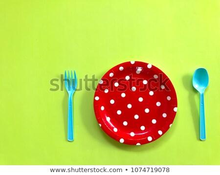 red polka dot dishes stock photo © Mikola249