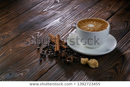 espresso with milk froth cocoa powder and cinnamon sticks on white stock photo © rob_stark