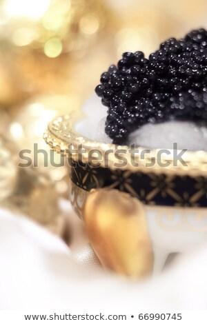 Luxe gouden kaviaar voorgerechten geïsoleerd witte Stockfoto © Klinker