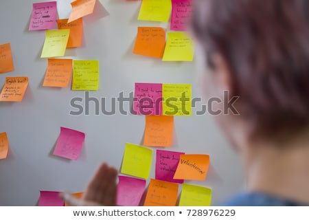 Casual businessman writing on sticky notes Stock photo © wavebreak_media