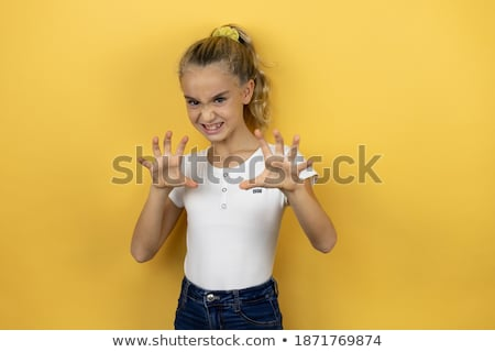 Young blond girl furiously scratches  Stock photo © fanfo