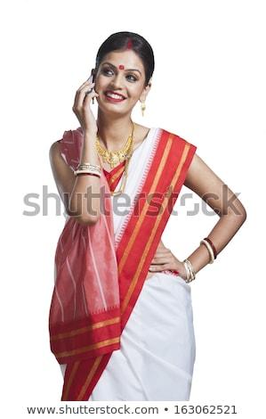 Hagyományos nő beszél mobiltelefon technológia mosolyog Stock fotó © imagedb