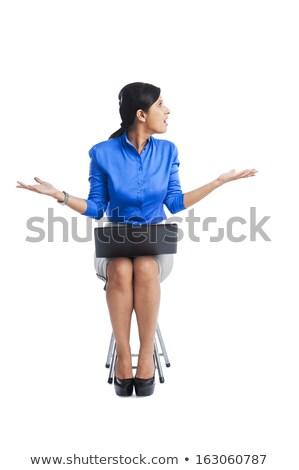 деловая женщина глядя расстраивать сидят стул используя ноутбук Сток-фото © imagedb