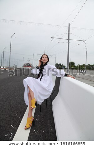 Woman in Trendy Clothes Sitting on the Pathway Stock photo © stryjek