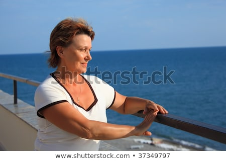 portrait of middleaged woman on balcony over sea Stock photo © Paha_L