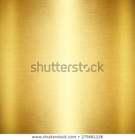 Złota metaliczny obyty tekstury streszczenie świetle Zdjęcia stock © ExpressVectors