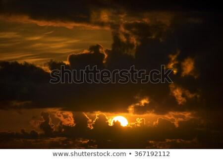 Donkere humeurig mosterd Geel zonsondergang hemel Stockfoto © morrbyte