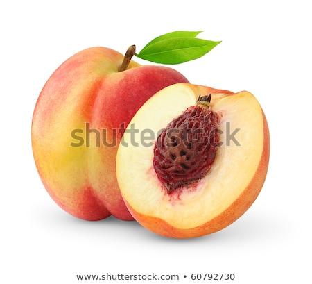 Nektarin gyümölcs mag közelkép fehér textúra Stock fotó © dezign56