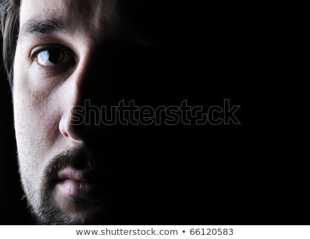 Low-key portrait - half face - sad and angry looking man Stock photo © zurijeta