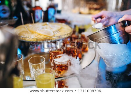 pyramid of champagne glasses with dry ice vapor stock photo © dariazu