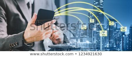 Férfi küldés email üzenet okostelefon lista Stock fotó © stevanovicigor