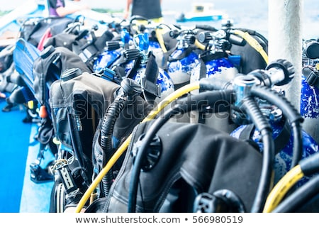 boat carrying oxygen flasks for scuba diving stock photo © kzenon