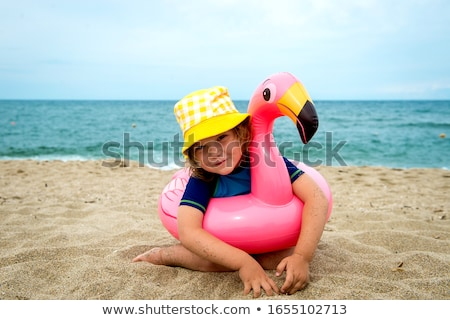 girl in swimsuit sits on rubber ring stock photo © bezikus