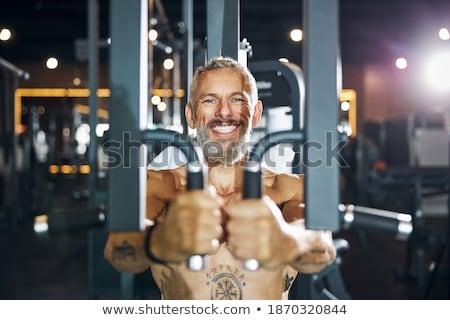Mature Bodybuilder Is Working On His Chest Stock photo © Jasminko