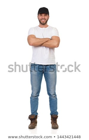 Handsome casual man smiling standing with legs crossed isolated Stock photo © deandrobot