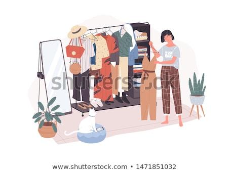 frau stehen kleid spiegel sch nen stock foto dean drobot deandrobot 7415967. Black Bedroom Furniture Sets. Home Design Ideas