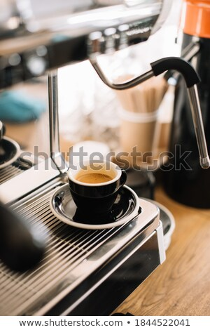 Coffee cup and maker on metal tray Stock photo © berczy04
