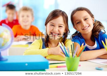 Mooie cute weinig schoolmeisje emotie witte Stockfoto © DenisMArt