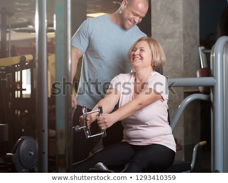 Fat man goes in for sports Stock photo © yuriytsirkunov