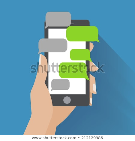 Hands holing white smartphone with blank speech bubble for text. Text messaging flat design concept. Stock photo © vasilixa