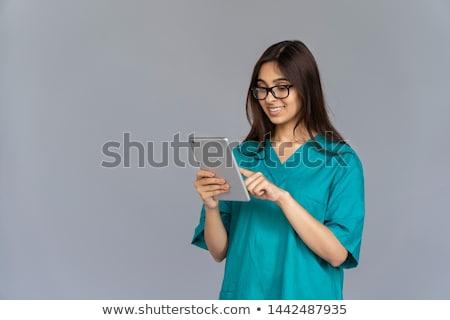 молодые женщины врач равномерный Сток-фото © deandrobot