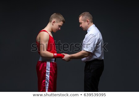 referee checking young boxer stock photo © svetography