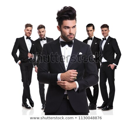 side portrait of young elegant man fixing his sleeve Stock photo © feedough