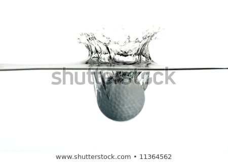plunge in the water of a golf ball  Stock photo © rufous