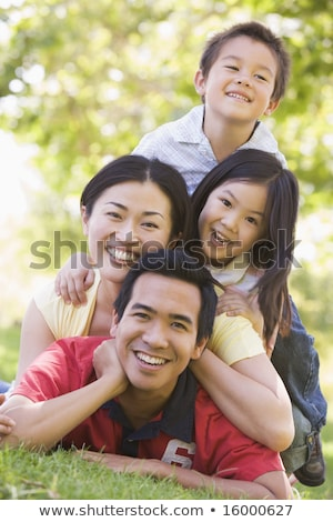 Family lying outdoors smiling Stock photo © monkey_business