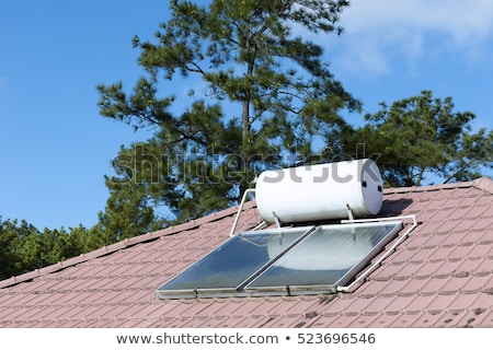 Stockfoto: Roof House Home Solar Panel Hot Water Heating Tube