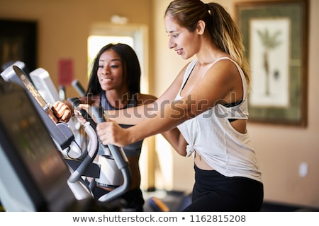 Stock photo: Personal Trainer Instructing Woman On Treadmill