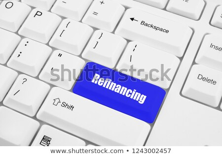 Blue Refinancing Button on Keyboard. Stock photo © tashatuvango