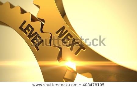 golden cog gears with next level concept stock photo © tashatuvango