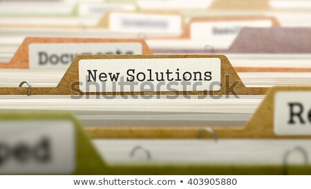 Folder Register with New Solutions. 3D. Stock photo © tashatuvango