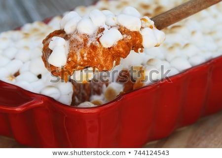 spoonful of sweet potato casserole baked with mini marshmallows stock photo © stephaniefrey