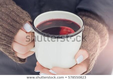 Stock photo: holding hot mulled wine