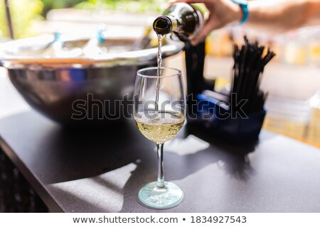Mano bandeja amarillo champán botellas blanco Foto stock © DenisMArt