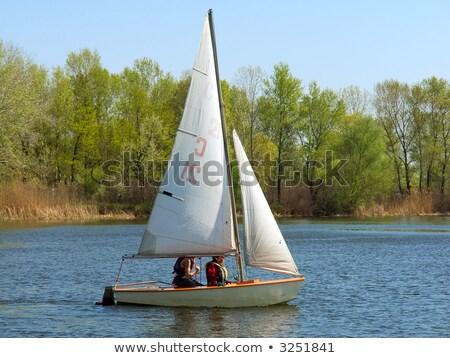 Teenage girls on sailboat stock photo © IS2