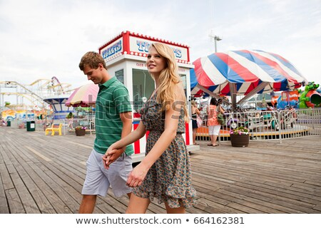 Teenage couple at boardwalk fun fair stock photo © IS2