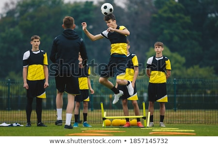 Boy heading a football Stock photo © IS2