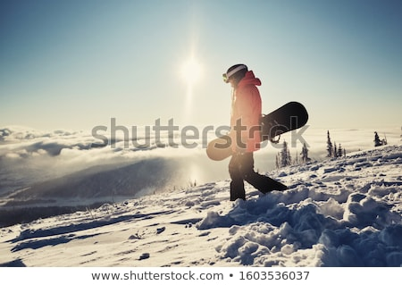 Woman snowboarding Stock photo © IS2