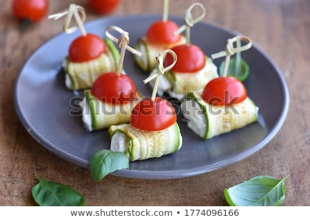 zucchini slices with cream and basil Stock photo © M-studio