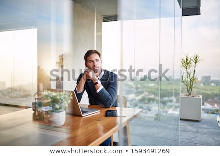Young man looking up while thinking of a new idea Stock photo © Giulio_Fornasar