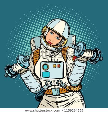 Mulher astronauta halteres retro Foto stock © studiostoks