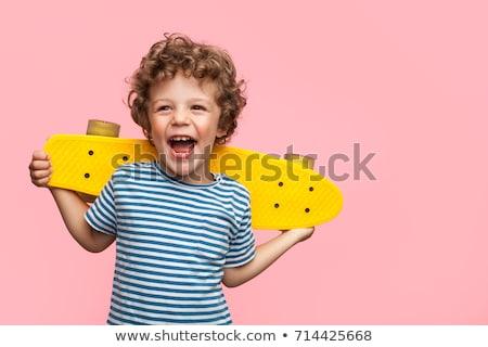 Imádnivaló görkorcsolyázó fiú pózol játszótér fa Stock fotó © acidgrey